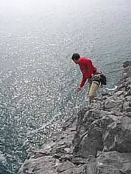 Abseiling into rock climb